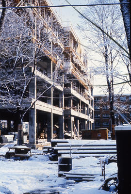 Photograph of construction of the Tupper Building, snow covered