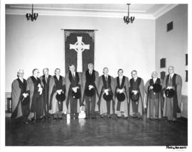 Photograph of several men in academic dress at the opening ceremony of the Sir James Dunn Building