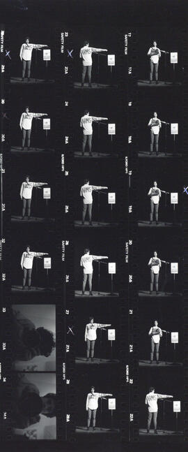 Contact sheet of photographs of Cathy Quinn's performance at the 1985 Arts and Culture Assembly