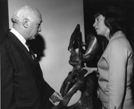 Photograph of Henry Hicks and an unidentified woman with a statue