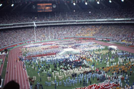 Photograph of the opening day ceremony with the Olympic flame