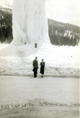 Photograph of Thomas Head and Edith Raddall in front of a frozen fountain in the Dolomites, Italy