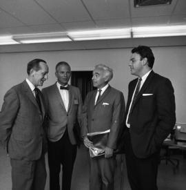 Photograph of four unidentified people at an event for the Dalhousie medical centennial
