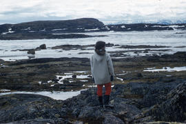 Photograph of Sue standing on rocks in Frobisher Bay, Northwest Territories