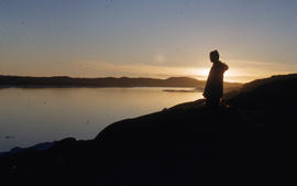 Photograph of a woman looking out over Frobisher Bay, Northwest Territories