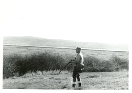 Photograph of Thomas Head Raddall hunting pheasants in the marshes at Port Royal, Upper Granville