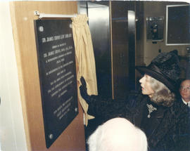 Photograph of Lady Beaverbrook unveiling a plaque in honour of Sir James Dunn