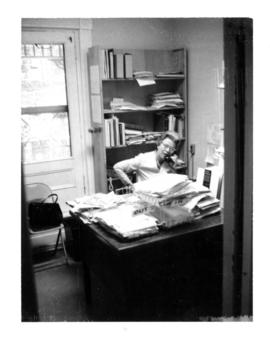 Photograph of the Librarian in office of the Medical-Dental Library at 5963 College Street