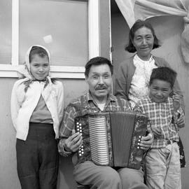 Photograph of Jimmy Koneak, his wife, and two children in Fort Chimo, Quebec