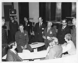 Photograph of Michael Kirby, Michael McGwire, Henry Hicks, and others at the NORAD headquarters