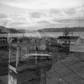 Double exposure photograph of a group of small houses in northern Quebec