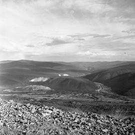 Photograph taken from a hill overlooking a valley in the Yukon