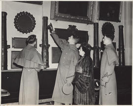 Photograph of Ellen Ballon touring the West Point museum with cadets