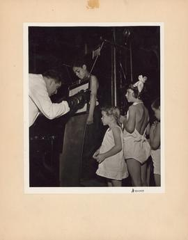 Photograph of doctor taking x-rays of children at the Outpatient and Public Health Clinic