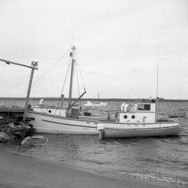 Photograph of fishing boats and canoes on the water in Northern Quebec