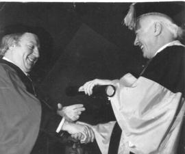 Photograph of Henry Hicks conferring an honorary degree on Isaac Stern