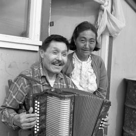 Photograph of Jimmy Koneak and his wife with an accordion in Fort Chimo, Quebec