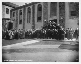 Photograph of a group of people standing outside of the Studley gym