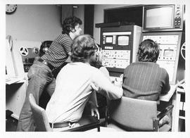 Photograph of three unidentified people operating television equipment