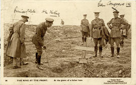 Photograph of George V at the grave of a soldier on the front lines of the Great War printed on a...