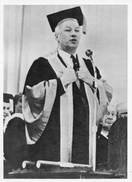Photograph of Henry Hicks speaking at a concovation ceremony