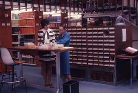 Photograph of the W.K. Kellogg Health Science Library staff and library catalogue