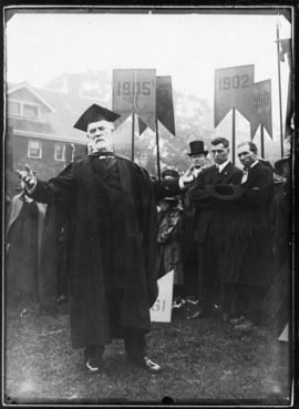 Photograph of Dr. John Forrest addressing a gathering at Dalhousie University's centenary ce...