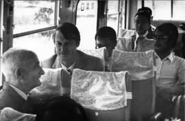 Photograph of unidentified people on a bus
