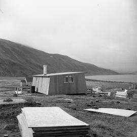 Photograph of a carpenter's house surrounded by construction materials in northern Quebec