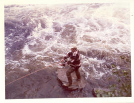 "Photograph of David Archibald casting a line from the ""fishing rock"" below the falls on Serpentin..."