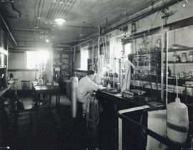 Photograph of a man in a chemical research laboratory in the Science Building