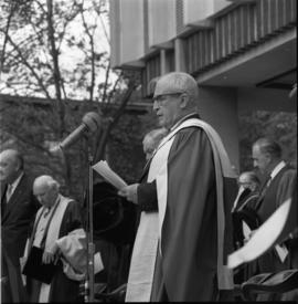 Photograph of A. E. Kerr speaking at the Dalhousie medical centennial convocation ceremony