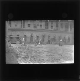 Photograph of unidentified soldiers and people next to a YMCA building