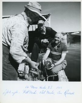 Photograph of Will and Neil Mosher and Thomas Head Raddall at Moose Harbour, Nova Scotia