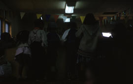 Photograph of several children in a hall