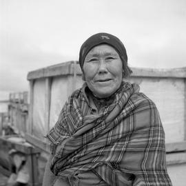 Portrait of Minnie Manna wearing a tartan shawl in Fort Chimo, Quebec