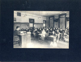 Photograph of children being taught in a one-room classroom