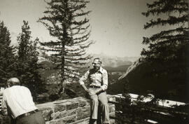 Photograph of two people sitting at a lookoff in Alberta