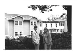 Photograph of two students standing in front of Eliza Ritchie Hall