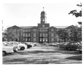 Photograph of the Arts and Administration building and campus parking lot