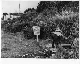 Photograph of two people at a well in Africville
