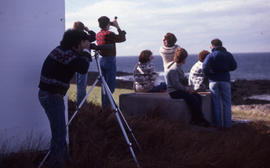Photograph of Bill Freedman using binoculars on Brier Island, Nova Scotia