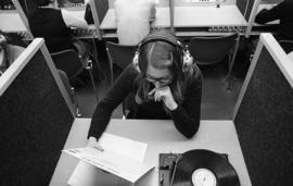 Photograph of a student listening to a record