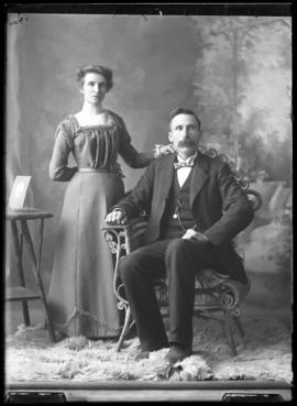 Photograph of Janet Reid & a male friend