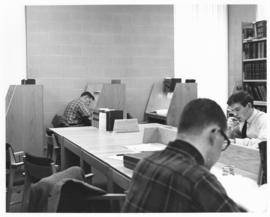 Photograph of students working at desks in the Sir James Dunn Law Library
