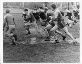 Photograph and a photographic negative of a rugby match
