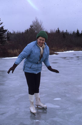 Photograph of Barbara Hinds skating on a pond