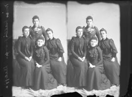 Photograph of Miss Bell and unknown individuals