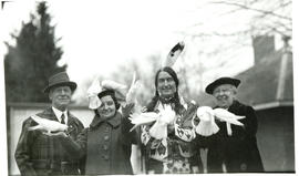 Photograph of Grey Owl with Jack Miner and two unnamed women holding birds at Miner's bird sanctu...