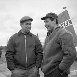 Photograph of Jacques Dumas and George Koneak talking together in Fort Chimo, Quebec